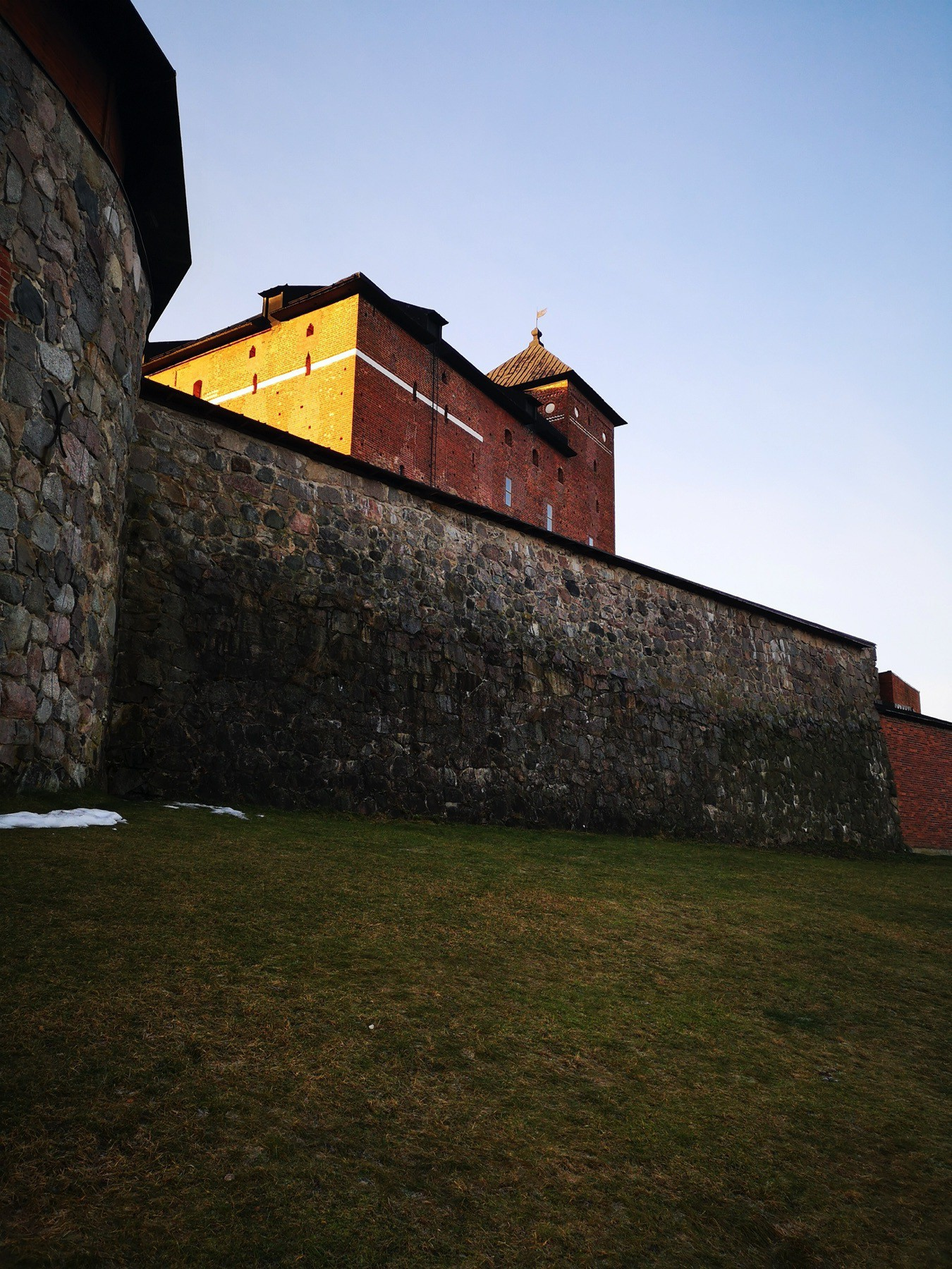 Häme castle lighted with rays of January sun