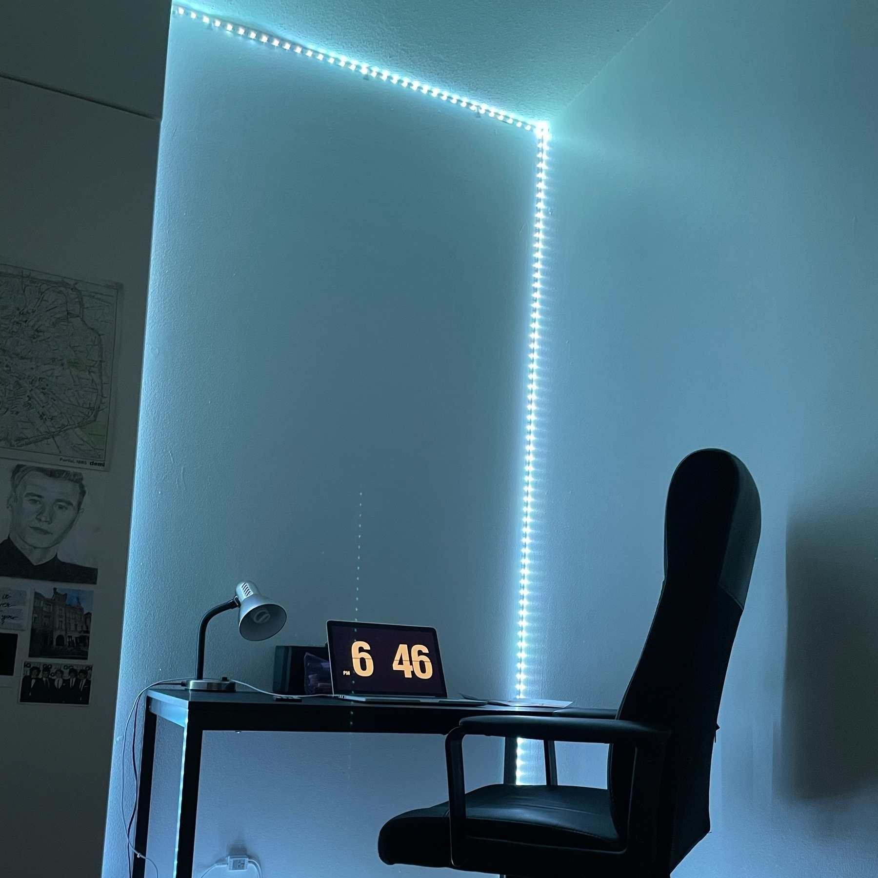 desk, laptop, desk lamp and an office chair in a led strip light