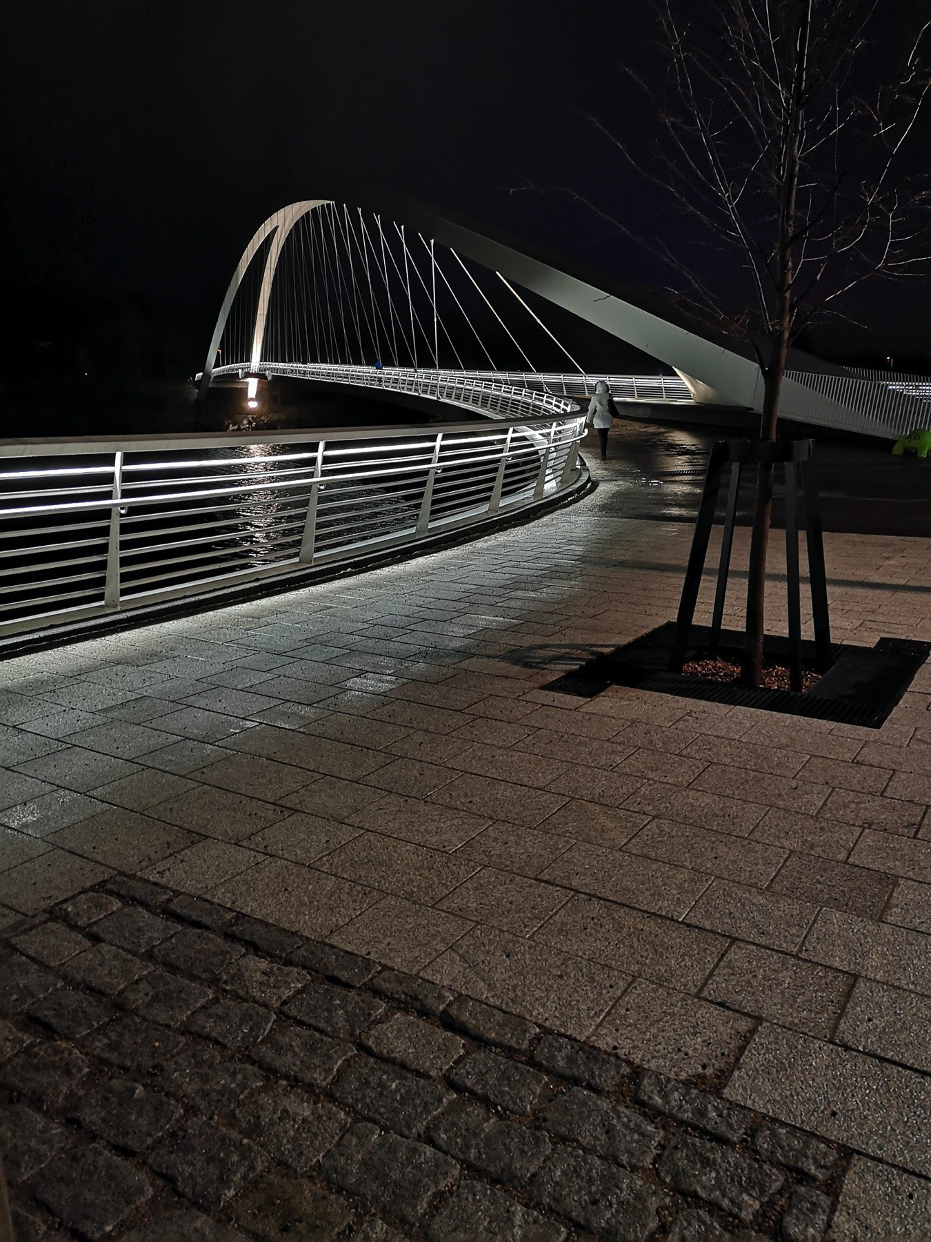 Isoisänsilta bridge in Kalasatama, Helsinki in complete darkness looking like there is nothing on the other side