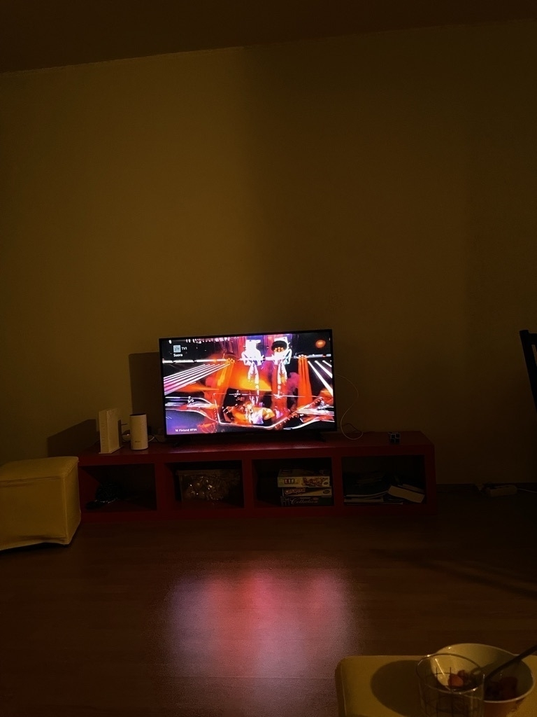 TV in dark room showing Eurovision song contest