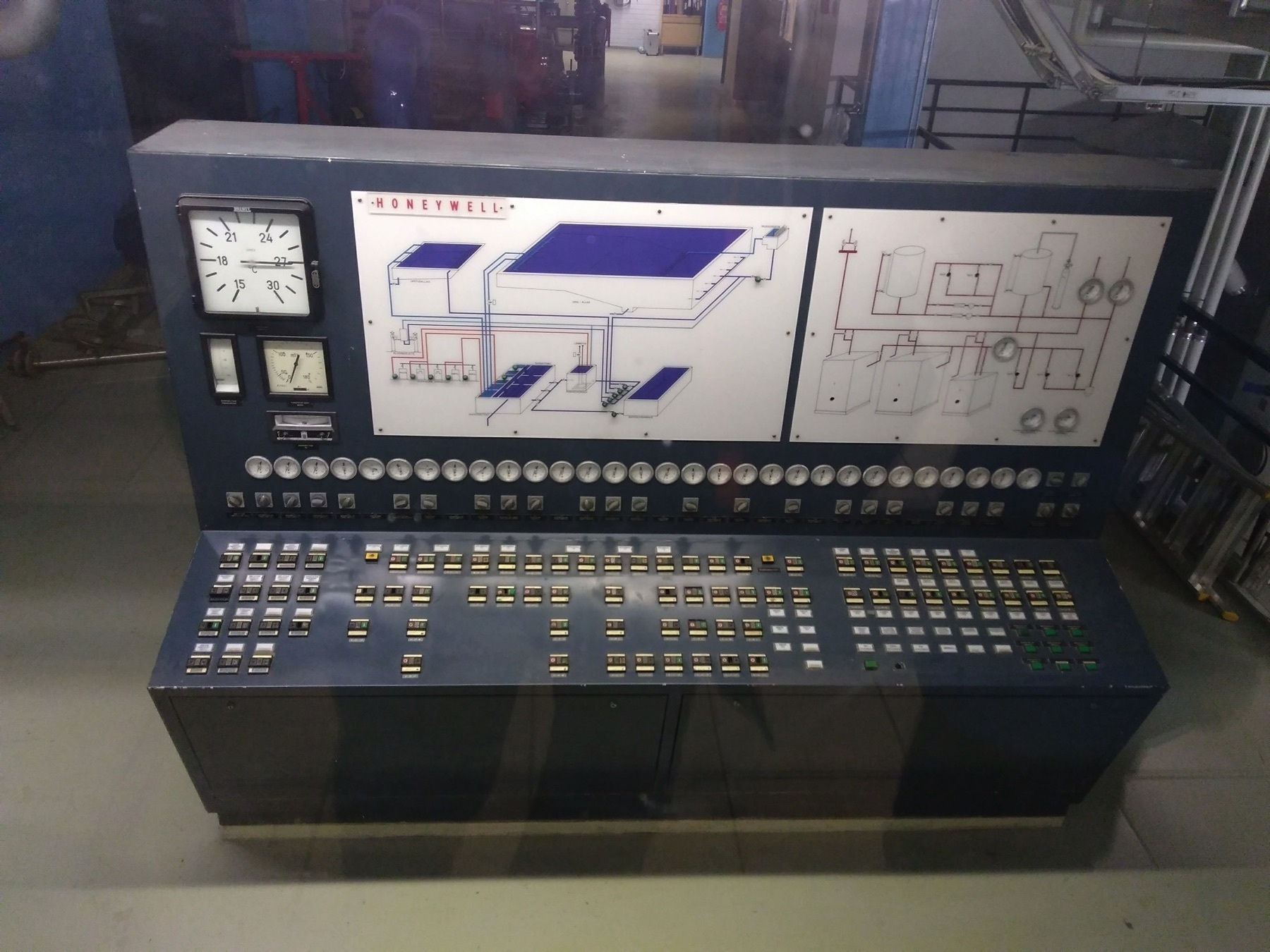 Honeywell branded swimming pool dashboard, dozens of gauges, nobs and an illustration of the pool water circulation