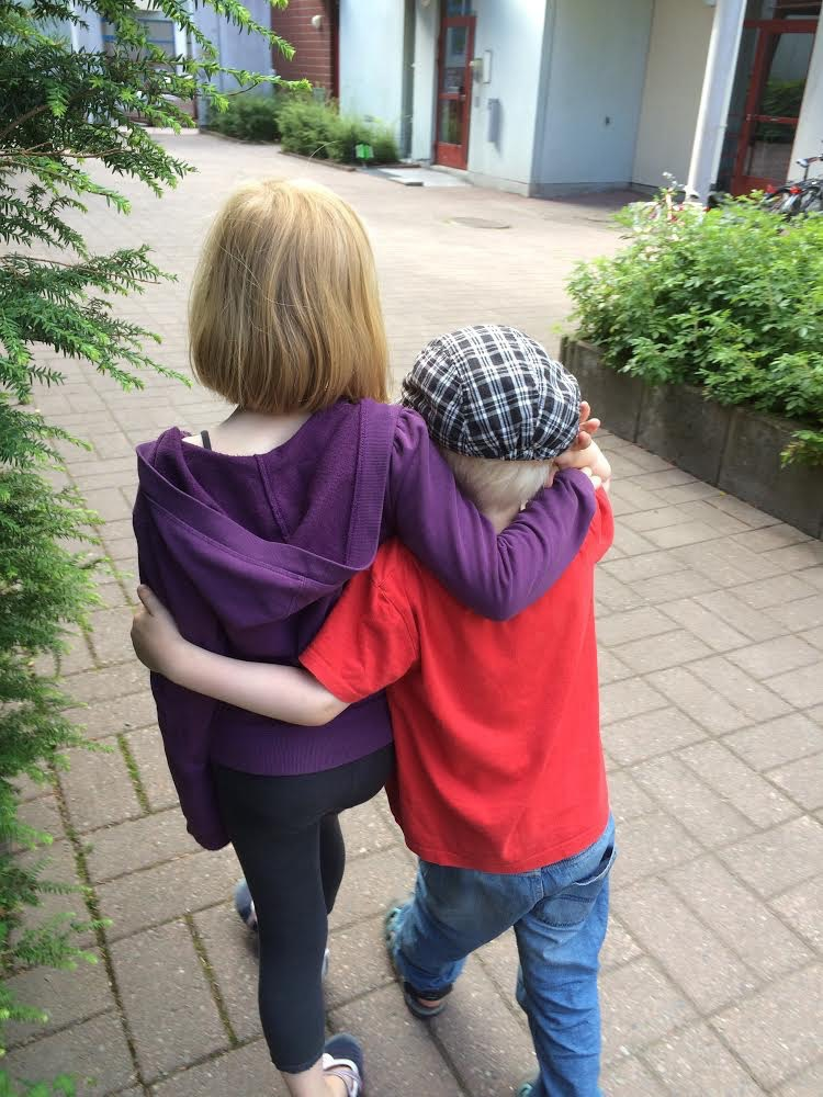 seven year old kid hugging a four year old