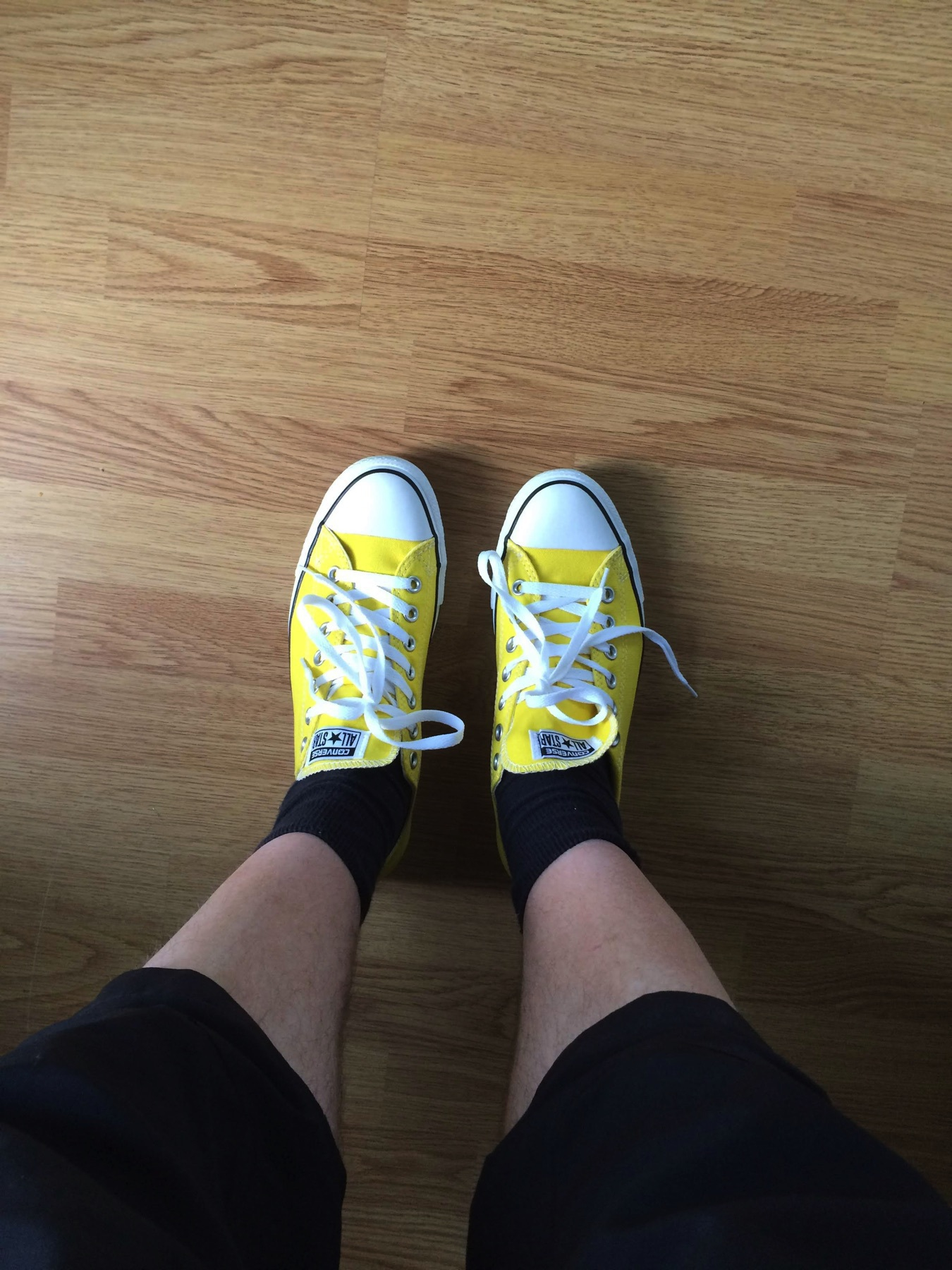 yellow converse all stars, floor, two feet
