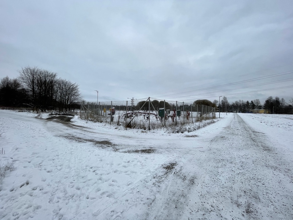 natural gas pumping station, snow, footprints, gravel on pathways