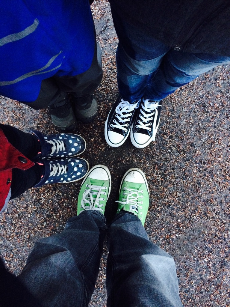 shoes in a circle, green converse, black converse, polka dot sneakers, kids' winter boots